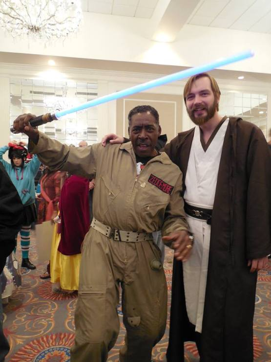 Ernie Hudson using my lightsaber at Super Megafest 2013