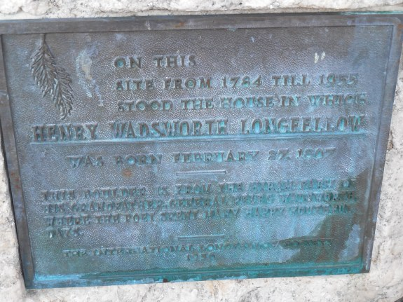 Close up of plaque on the rock denoting Longfellow's place of birth