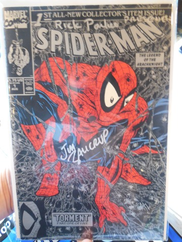 A signed copy of Spider-Man #1 from Rick. He drew pupils in Spidey's eyes.