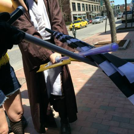 Me (in the robes as Obi-Wan) crossing my lightsaber with Joe's Riddler staff on Free Comic Book Day, 2014.