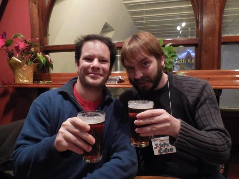 Richard and me sharing a beer at a restaurant.