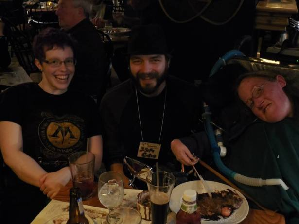 Sharing a photo op with Shawna and a fellow Stonecoaster during a Stonecoast dinner.