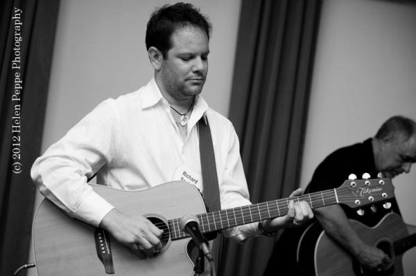 Richard playing guitar with novelist and playwright Michael Kimball. Photo by Helen Peppe.