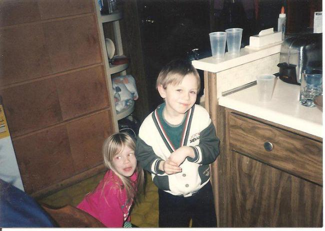 Chad when he was only seven years old, pictured with my sister Monika.