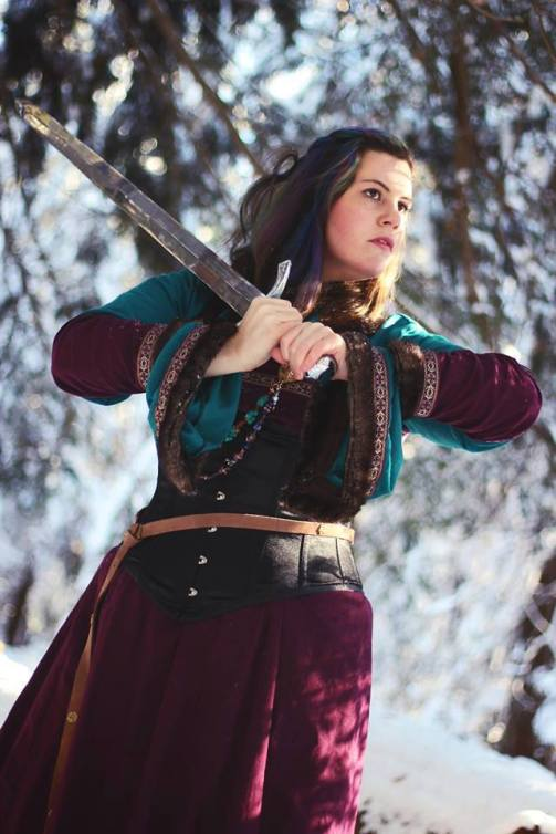 """Cosplaying as her own character in """"Viking Fantasy"""" garb (a twist on historically-accurate Viking wear). Photo by Kara Jean Marston. Taken in the Maine woods."""