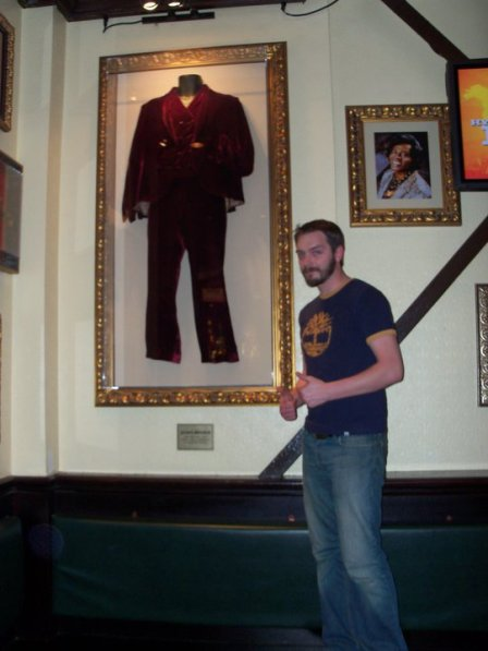 Me at Hard Rock Cafe in Baltimore, next to James Brown's outfit.