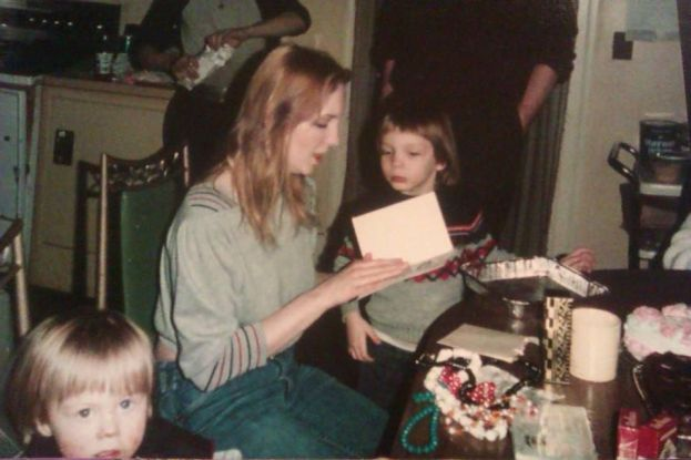 Gary is on the lower left and I'm examining a birthday card with my mother in the center of the photo. I would've been around four or five years old here, I think.