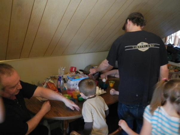Richie on the right coloring eggs with his nephews and nieces. His father (my stepfather) is on the left.
