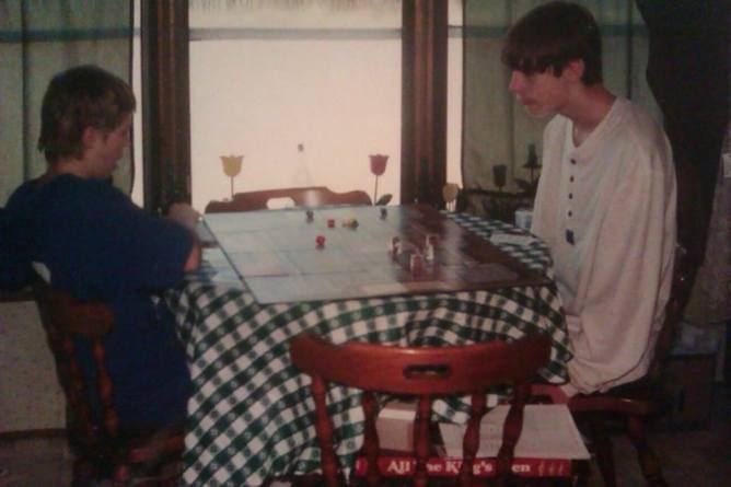 Gary and me playing a fantasy board game. We played board games and video games together all the time.