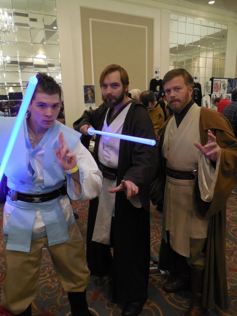 Me at Super Megafest as Obi-Wan Kenobi in the middle, flanked by two other (one younger, one older) Obi-Wans.