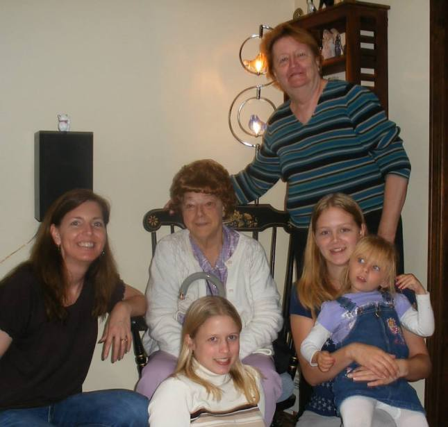 Nana in the center, surrounded by family.