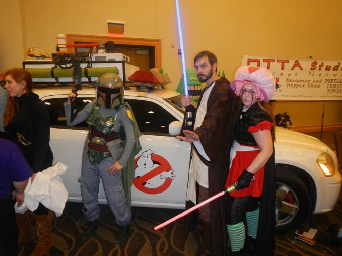 Me with my girlfriend Dorothy posing with Linsey next to a Ghostbusters car at Bangor Toy And Comicon 2015.