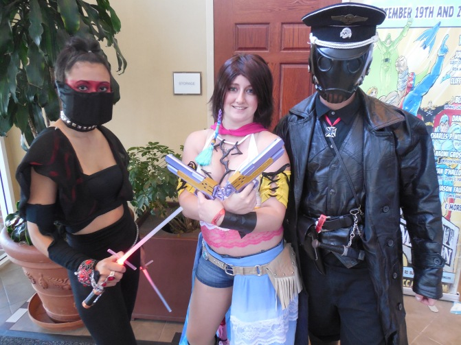 My friend Cheryl Wild (WyldRyce Cosplay) on the left as her own creation: A Ninja Sith Lord. Also to the right are a good Yuna and Kroenen.