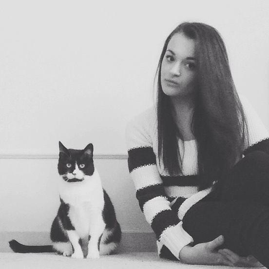 Alicia with her cat, Jaxx.