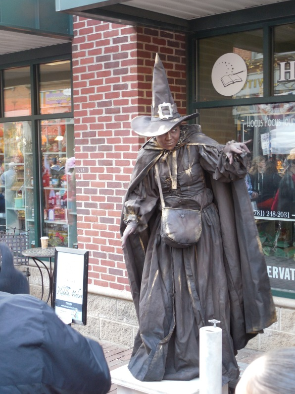 A busking witch in Salem